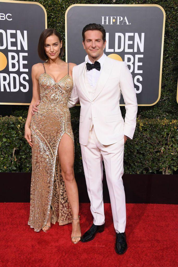 Irina Shayk in Versace si Bradley Cooper in Gucci